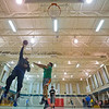 JAY YOUNG | THE GOSHEN NEWS<br /> Jose Lopez shoots a hook shot over his son Ivan, 10, both of Goshen, as the two shoot around Monday evening at Waterford Elementary before the start of a youth league basketball practice hosted by the Goshen Parks and Recreation Department. The league runs now through the end of March and features eight teams. They practice one night a week and then play games on Saturdays.