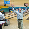 JAY YOUNG | THE GOSHEN NEWS<br /> Rick Yoder raises his arms in celebration after rolling a strike on the tenth frame during the ninth annual Spare Time at the Chamber bowling event on Thursday afternoon at Maple City Bowling.  Yoder was representing Edward Jones. Twenty teams made up of five bowlers each took part in the event hosted by the Goshen Chamber of Commerce.