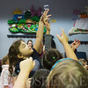 JAY YOUNG | THE GOSHEN NEWS<br /> Four-year-old Josephine Garber, of Goshen, reaches high to pop a bubble during Storytime at the Goshen Public Library on Wednesday morning.