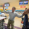 JAY YOUNG | THE GOSHEN NEWS<br /> Rick Yoder gets a high-five after rolling a strike in the10th frame of his game during the ninth annual Spare Time at the Chamber bowling event Thursday afternoon at Maple City Bowl.  Yoder was representing Edward Jones. Twenty teams made up of five bowlers each took part in the event hosted by the Goshen Chamber of Commerce.
