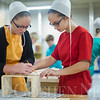 JAY YOUNG | THE GOSHEN NEWS<br /> Millersburg Elementary seventh grade students Bethany Wingard, left, and Julia Miller, work together on a wooden crate project during shop class on Wednesday afternoon.