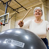 JAY YOUNG | THE GOSHEN NEWS<br /> Elkhart resident Carol Bissell takes part in a cardio drumming class at the Tolson Center in Elkhart on Monday morning.