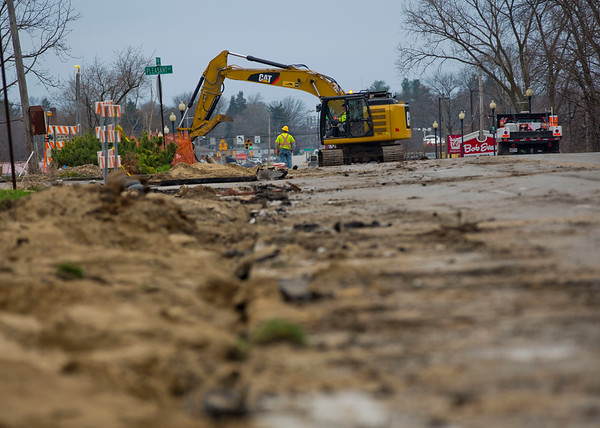 JAY YOUNG | THE GOSHEN NEWS<br /> A trail of destruction is left in the wake of a construction crew as they use a backhoe to rip up the shoulder and sidewalk along Pike Street near Pleasant Drive on Monday afternoon. The construction is due to the ongoing U.S. 33 realignment project. The 0.2 mile stretch of highway will be reconstructed and widened as part of the first phase of the project. Expect the closure to last for up to three months.