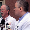 Roger Schneider | The Goshen News<br /> Concord Fire Chief Rich Rochford, left, and Elkhart County Health Officer Daniel Nafziger, speak at an update on the fire burning at the Waste Management landfill south of Elkhart.
