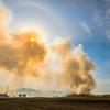 JAY YOUNG | THE GOSHEN NEWS<br /> A tower of smoke blocks out the sun as it rises from a fire at Waste Management's Earthmover landfill, located at 26488 C.R. 26, Wednesday morning.