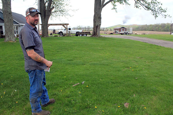 Roger Schneider | The Goshen News<br /> Michael Smith stands in his yard to the south of the Waste Management's Earthmovers landfill fire Wednesday afternoon.
