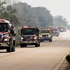 JAY YOUNG | THE GOSHEN NEWS<br /> A convoy of firetrucks from across the county rumbles down C.R. 26 as they respond to a fire at Waste Management's Earthmover landfill, located at 26488 C.R. 26, Wednesday morning.