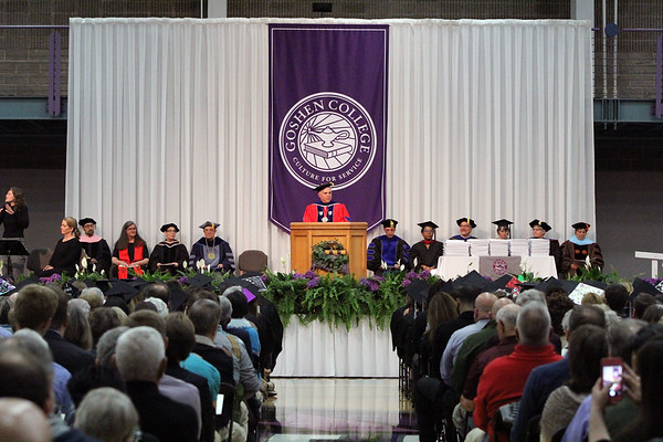 JULIE CROTHERS BEER | THE GOSHEN NEWS<br /> Outgoing Goshen College President Jim Brenneman speaks to graduates from the podium Sunday during 2017 commencement ceremony at the college.