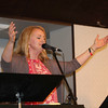 SHEILA SELMAN | THE GOSHEN NEWS<br /> Sherry Vaughn of The River of Life Community Church in Elkhart leads the worship service during National Day of Prayer at Life Spring Church in downtown Goshen Thursday.