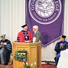 JULIE CROTHERS BEER | THE GOSHEN NEWS<br /> At right, Bruce Stahly, a member of the Goshen College Board of Directors, recognizes Goshen College President Jim Brenneman for his years of service to the college as the two shake hands during the 2017 commencement ceremony Sunday.