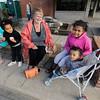 JULIE CROTHERS BEER | THE GOSHEN NEWS<br /> Brenda Cripe of Goshen stops for a pretzel snack with her grandchildren, from left, Toluope Busari, 7, Olatundun Busari, 3, Yetunde Busari, 9, and Money Busari, 1, during First Fridays in Goshen.