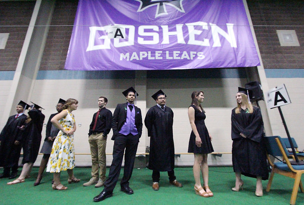 JULIE CROTHERS BEER | THE GOSHEN NEWS<br /> Goshen College 2017 graduates Dusti Diener, Mitch Denlinger, AJ Delgadillo, Josue DeLaRosa, Anna Cullar and Kate Crawford wait in line before entering the gymnasium for commencement Sunday.