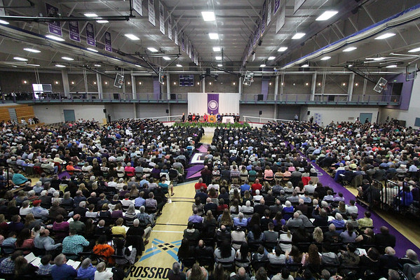JULIE CROTHERS BEER | THE GOSHEN NEWS<br /> Goshen College students, staff and family and friends of the graduates gather in the Roman Gingerich Recreation-Fitness Center at Goshen College for the 2017 commencement ceremony Sunday.