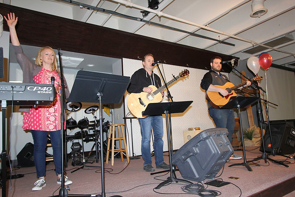 SHEILA SELMAN | THE GOSHEN NEWS<br /> Leading worship at National Day of Prayer at Life Spring Church in downtown Goshen are, from left, Sherry Vaughn of River of Life Community Church in Elkhart and David Cummings and Ryan Graham, both of Nappanee Missionary Church.