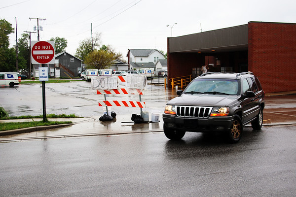 JOHN KLINE | THE GOSHEN NEWS<br /> An SUV pulls out of the First Street exit at the Goshen Post Office Thursday afternoon. The exit has become a safety concern for the office following the April closure of the Pike Street entrance for construction work, as customers have been using the exit as an entrance instead of the designated temporary entrance off of Wilkinson Street.