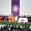 JULIE CROTHERS BEER | THE GOSHEN NEWS<br /> Bruce Stahly, a member of the Goshen College Board of Directors, recognizes Goshen College President Jim Brenneman for his years of service to the college during the 2017 commencement ceremony Sunday.