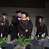 JULIE CROTHERS BEER | THE GOSHEN NEWS<br /> Julie Paston walks onto the stage to accept her diploma Sunday during the commencement ceremony at Goshen College.