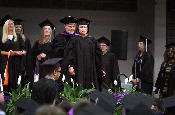 JULIE CROTHERS BEER | THE GOSHEN NEWS<br /> Alicia Navarro, of Middlebury, walks onto the stage to accept her diploma Sunday during the commencement ceremony at Goshen College.
