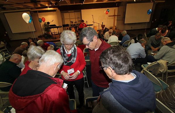 SHEILA SELMAN | THE GOSHEN NEWS<br /> Praying in a small circle among other prayer circles at National Day of Prayer Thursday are, starting at right and going clockwise, Willis Bontrager, Syracuse; Richard Miller, Syracuse; Mary Ellen Sisson, Goshen; and Bonnie and Woody Bailey, both of Goshen.