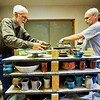 JAY YOUNG | THE GOSHEN NEWS<br /> Bob Smoker, left, and Fred Driver, both of Goshen, work to unload the kiln at the Clay Artists Guild Wednesday afternoon. The kiln, which held over 250 pieces, was fired on Monday at a temperature of 2350 degrees then allowed to cool for 48 hours. The pottery pieces are for the upcoming Spring Pottery Sale that begins Friday at 6 p.m.