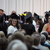 JULIE CROTHERS BEER | THE GOSHEN NEWS<br /> Goshen College graduates turn to thank their families and friends for attending Sunday's commencement ceremony.