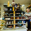 JAY YOUNG | THE GOSHEN NEWS<br /> Patty Burns, of Goshen, begins to unload the kiln at the Clay Artists Guild Wednesday afternoon. The kiln, which held over 250 pieces, was fired on Monday at a temperature of 2350 degrees then allowed to cool for 48 hours. The pottery pieces are for the upcoming Spring Pottery Sale that begins Friday at 6 p.m.