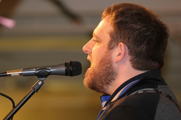 SHEILA SELMAN | THE GOSHEN NEWS<br /> Ryan Graham of Nappanee Missionary Church leads worship during National Day of Prayer at Life Spring Church in downtown Goshen Thursday.