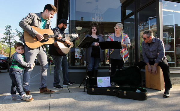 JULIE CROTHERS BEER | THE GOSHEN NEWS<br /> Members of the worship team from Sugar Grove Church in Goshen perform during First Fridays. Joined by Wyatt McClellan, 3, performers, from left, include Ian McClellan, Jesse Gutierrez, Janey Nicely, Heather Neil and Doug Rosezelle.