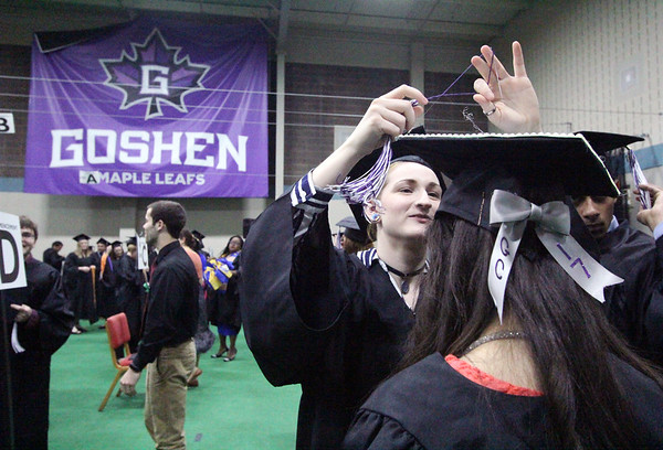 JULIE CROTHERS BEER | THE GOSHEN NEWS<br /> Emilie Schaeffer, a 2017 graduate of Goshen College, adjusts the tassle on the hat of her classmate before commencement began Sunday.