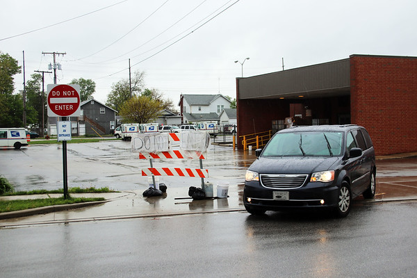 JOHN KLINE | THE GOSHEN NEWS<br /> A van pulls out of the First Street exit at the Goshen Post Office Thursday afternoon. The exit has become a safety concern for the office following the April closure of the Pike Street entrance for construction work, as customers have been using the exit as an entrance instead of the designated temporary entrance off of Wilkinson Street.