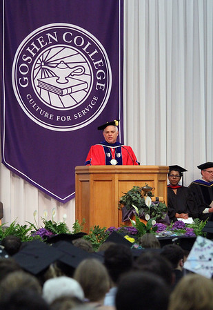JULIE CROTHERS BEER   THE GOSHEN NEWS<br /> Outgoing Goshen College President Jim Brenneman speaks to graduates from the podium Sunday during the 2017 commencement ceremony at the college.