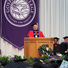 JULIE CROTHERS BEER | THE GOSHEN NEWS<br /> Outgoing Goshen College President Jim Brenneman speaks to graduates from the podium Sunday during the 2017 commencement ceremony at the college.