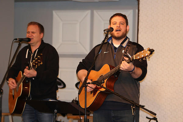 SHEILA SELMAN | THE GOSHEN NEWS<br /> David Cummings, left, and Ryan Graham, both of Nappanee Missionary Church, lead worship at National Day of Prayer at Life Spring Church in downtown Goshen Thursday afternoon.