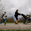 "JAY YOUNG | THE GOSHEN NEWS<br /> Four-year-old Alex Torres walks behind his aunt, Noemi Chacon, while she pushes her daughter, Adriana, 1, all of Elkhart, around a bike path at Oxbow Park Monday morning. The three were participating in a newly formed mommy stroller meetup group. About 20 mothers with their children participated in the event, which lasted about two hours. The goal, according or organizer Rachel Cunningham, was to help mothers make new ""mom-friends."""