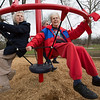 JAY YOUNG | THE GOSHEN NEWS<br /> Jeannine Martin, left, and Elaine Kersey, both of Elkhart, take the new playground equipment at Edgewater Park in Elkhart for a spin Tuesday afternoon during a ribbon cutting ceremony for the park.