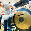 JAY YOUNG | THE GOSHEN NEWS<br /> Freshman Angel Baiza strikes a gong towards the end of the performance.