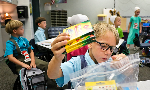 LEANDRA BEABOUT | THE GOSHEN NEWS<br /> Kindergartener Lavon Miller sorts his school supplies on the first day of school at Meadowview Elementary School.