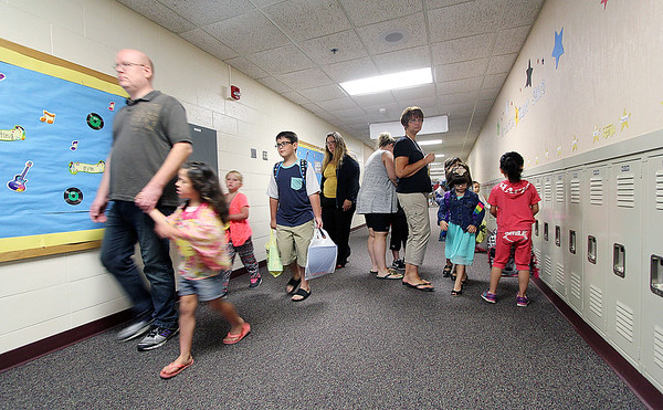JULIE CROTHERS BEER | THE GOSHEN NEWS<br /> Students at Nappanee Elementary School find their lockers and settle in for the first day of classes Wednesday.