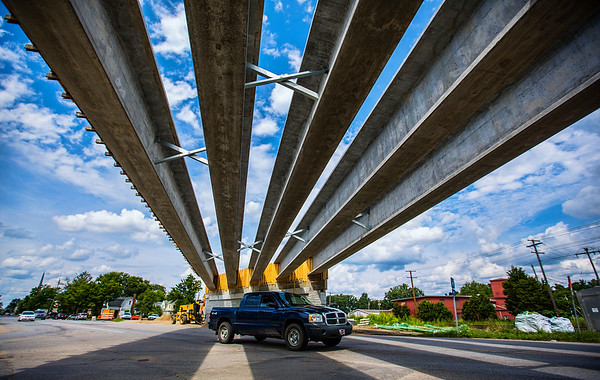 JAY YOUNG | THE GOSHEN NEWS<br /> A truck traveling east on Lincoln Avenue Monday afternoon passes under support beams that span the road and are part of the U.S. 33 overpass currently being built. After being closed for the  past two weeks near the railroad tracks, Lincoln Avenue is now open once again.