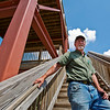 JAY YOUNG | THE GOSHEN NEWS<br /> Gary Plank stands on the new overlook tower in Oxbow Park Wednesday afternoon. Plank has spent the past 27 years working for Elkhart County Parks.