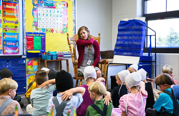 LEANDRA BEABOUT | THE GOSHEN NEWS<br /> Kindergarten teacher Abbey Harlan tells her students to give themselves a pat on the back for being good listeners on the first day of school at Meadoview Elementary School.
