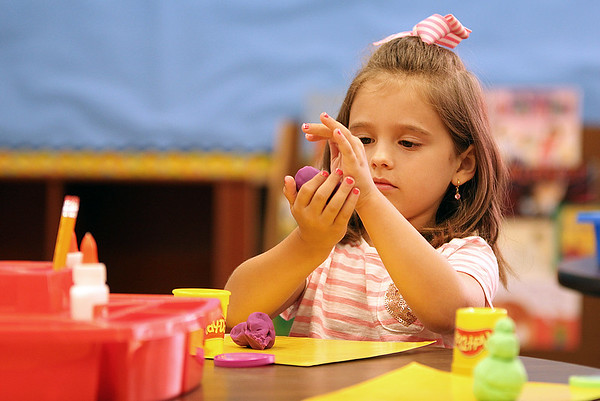 JULIE CROTHERS BEER   THE GOSHEN NEWS<br /> Kindergartner Ava Morningstar works with Play-doh on her first day of school Wednesday at Nappanee Elementary School.