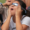 Roger Schneider | The Goshen News<br /> Leslie Valencia is amazed by the solar eclipse she is seeing through her solar viewing glasses. Valencia was with her Concord Intermediate School sixth-grade classmates viewing the eclipse.
