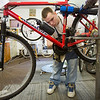 JAY YOUNG | THE GOSHEN NEWS<br /> Matthew Lemons, of Elkhart, cleans and oils the chain on a mountain bike Wednesday morning at Chain Reaction Bicycle Project, 510 East Washington Street. Lemons was at the shop to find a bicycle for himself. The shop allows anyone to work off the price of a bicycle by working in the shop.