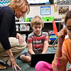 LEANDRA BEABOUT | THE GOSHEN NEWS<br /> Second-grade teacher Lori Henley helps her student, James Pifer, find a reading activity on one of the classrooms new Chromebooks.