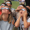 Roger Schneider | The Goshen News<br /> Leslie Valencia,right, a Concord Intermediate School sixth-grader, is amazed by the solar eclipse Monday.She is watching the eclipse with her classmates, including Addison May, at left.