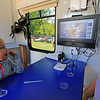 Roger Schneider | The Goshen News<br /> Kyle Cripe, 5, of Middlebury, is excited seeing a damselfly larvae on a microscope display screen. Cripe and her brother Jacob were at the Middlebury Riverfest Saturday and took part in science activities at mobile Ethos Science Center.