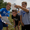 JAY YOUNG | THE GOSHEN NEWS<br /> Bethany Christian sixth-grade students, from left, James Lind, 11, Daven Molina, 11, and Jayden Schlabach, 11, use a makeshift pinhole camera to watch Monday's solar eclipse on the front lawn of the school.