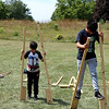 SHERRY VAN ARSDALL | THE GOSHEN NEWS<br /> At right, Miguel Becerra, 13, Dunlap, tries to balance on wooden stilts during the 50th celebration of Elkhart County Parks at Ox Bow County Park in Dunlap Sunday afternoon.