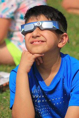 Roger Schneider | The Goshen News<br /> Akash Agarwal views the solar eclipse Monday through special glasses. Agarwal was watching the event with his Concord Elementary School classmates.
